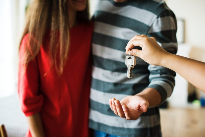 keys being handed to a couple who are buying a new house