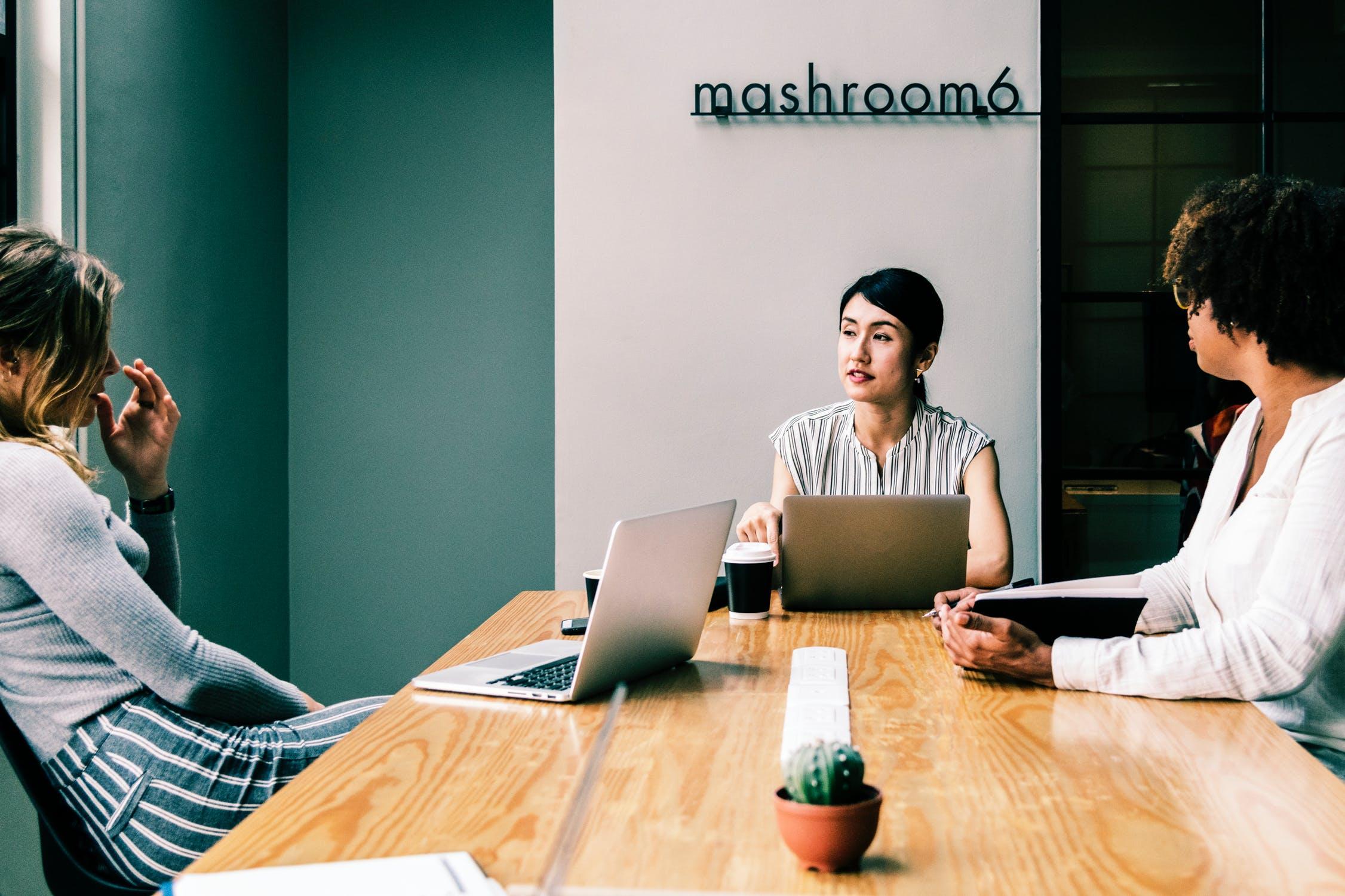 entrepreneurs talking around a table